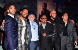 """(FILES) In this file photo taken on January 14, 2020 (L-R) Director Adil El Arbi, actors Will Smith, Joe Pantoliano, Martin Lawrence, director Bilall Fallah and actor Charles Melton arrive for the World Premiere of """"Bad Boys For Life"""" at the TCL Chinese theatre in Hollywood. It took Sony 17 years, but the latest """"Bad Boys"""" sequel appears to be paying off, taking in an estimated $59.2 million for the start of a US holiday weekend, industry watcher Exhibitor Relations reported on January 19, 2020. """"Bad Boys for Life"""" stars Will Smith and Martin Lawrence as wise-cracking detectives who reunite after years apart (""""Bad Boys II"""" dates from 2003, eight years after the original """"Bad Boys"""") to take on a murderous Miami drug cartel.  Frederic J. BROWN / AFP"""