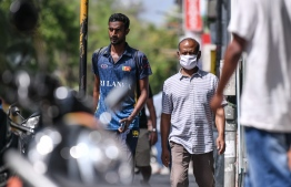 Malé, March 19, 2020: A man pictured walking on the streets wearing a face mask. Many in Malé city are seen wearing face masks to protect themselves against COVID-19. PHOTO: AHMED AWSHAN ILYAS/MIHAARU