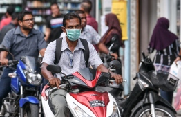 Malé, March 19, 2020: Many in Malé city are seen wearing face masks on their motorcycles as a precautionary measure against COVID-19. PHOTO: AHMED AWSHAN