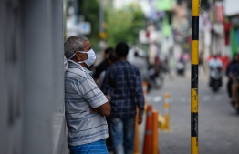 Malé, March 19, 2020: A man pictured wearing a face mask—many in Malé city are seen wearing face masks to protect themselves against COVID-19. Health professionals however advised against the use of surgical masks, unless an individual showed symptoms for COVID-19. PHOTO: AHMED AWSHAN ILYAS/MIHAARU