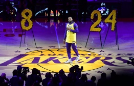 Los Angeles Lakers player LeBron James speaks from center court in honour of NBA legend Kobe Bryant, after he was killed last weekend in a helicopter accident, ahead of a game between Los Angeles Lakers and Portland Trail Blazers, at the Staples Center in Los Angeles, California on January 31, 2020. (Photo by Frederic J. BROWN / AFP)