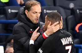 "Paris Saint-Germain's French forward Kylian Mbappe (R) speaks with Paris Saint-Germain's German coach Thomas Tuchel as he leaves the pitch after his substitution during the French L1 football match between Paris Saint-Germain (PSG) and Montpellier Herault SC at the Parc des Princes stadium in Paris, on February 1, 2020. - Paris Saint-Germain coach Thomas Tuchel admitted Neymar's latest lavish birthday celebrations were a ""distraction"" at a key time in the season after the Brazilian helped the Ligue 1 leaders to a 5-0 win over nine-man Montpellier, Neymar, with his hair dyed pink, shook off an injury scare and raged with the match officials while Pablo Sarabia, Angel Di Maria, Kylian Mbappe and Layvin Kurzawa all scored along with a Daniel Congre own goal as PSG went 13 points clear of Marseille at the top of the table. (Photo by FRANCK FIFE / AFP)"