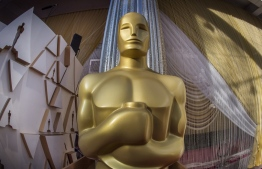 An Oscars statue is displayed on the red carpet area on the eve of the 92nd Oscars ceremony at the Dolby Theatre in Hollywood, California, on February 8, 2020. (Photo by Mark RALSTON / AFP)