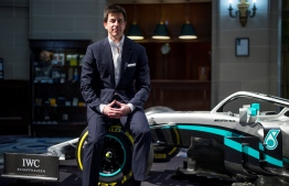 "Mercedes AMG Petronas F1 Team's team principal Toto Wolff poses for a photograph during a media event to reveal the team's new livery for the upcoming 2020 season, at the Royal Automobile Club in London on February 10, 2020. - Mercedes Formula 1 boss Toto Wolff said on Monday that his team's tie-up with Lewis Hamilton is the ""obvious pairing"", with the future of the six-time world champion still unclear on the eve of the new season. ""It is the obvious pairing going forward,"" said Wolff as Mercedes unveiled a five-year partnership with Jim Ratcliffe's chemicals company Ineos in London. (Photo by Tolga AKMEN / AFP)"