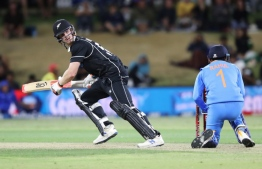 New Zealand's James Neesham (L) plays a shot in front of India's KL Rahul during the third one-day international cricket match between New Zealand and India at the Bay Oval in Mount Maunganui on February 11, 2020.  MICHAEL BRADLEY / AFP