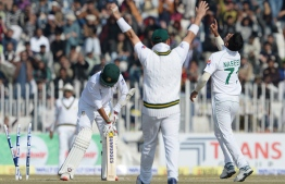 Pakistan's bowler Naseem Shah (R) celebrates after taking the wicket of Bangladesh's Saif Hassan (L) during the third day of the first cricket Test match between Pakistan and Bangladesh at the Rawalpindi Cricket Stadium in Rawalpindi on February 9, 2020. (Photo by AAMIR QURESHI / AFP)