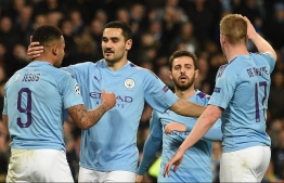 (FILES) In this file photo taken on November 26, 2019 Manchester City's German midfielder Ilkay Gundogan (2L) celebrates scoring the opening goal during the UEFA Champions League football Group C match between Manchester City and Shakhtar Donetsk at the Etihad Stadium in Manchester, north west England. - Manchester City said they would appeal to the Court of Arbitration for Sport after being hit with a two-season ban from European competition on Friday, February 14. (Photo by Oli SCARFF / AFP)