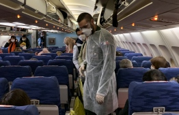 In the wake of the novel respiratory coronavirus that originated in Wuhan, China, now named 'COVID-19', Maldivian authorities on February 3, announced a ban on travellers arriving from China and suspended all flights to and from China as a precautionary measure to combat the spread of the disease. Photo: HECTOR RETAMAL / AFP