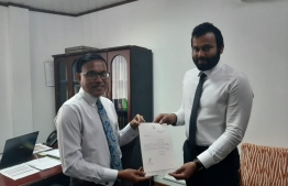 Faisal Adam being presented with his letter of appointment. PHOTO: SUPREME COURT