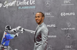 Laureus World Sportsman of the Year nominee Lewis Hamilton poses on the red carpet prior to the 2020 Laureus World Sports Awards ceremony in Berlin on February 17, 2020. (Photo by Tobias SCHWARZ / AFP)