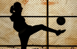 A female footballer practicing in Amuda, Syria. PHOTO: AFP