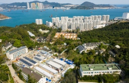 An aerial photo shows Lei Yue Mun Park and Holiday Village, the city's largest quarantine site, which is being used to house people identified as having contact with confirmed cases of the COVID-19 coronavirus, in Hong Kong on February 17, 2020. (Photo by Anthony WALLACE / AFP)