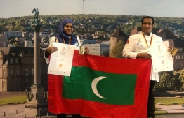 The two winners from Maldives holding up the national flag along with their certificates. PHOTO: CHEF'S GUILD OF MALDIVES