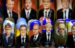 Traditional Russian wooden nesting dolls, called Matryoshka dolls, depicting Russia's President Vladimir Putin and other political leaders are seen on sale at a souvenir stall in Saint Petersburg on January 29, 2020. - Twenty years after he came to power, President Vladimir Putin is omnipresent on the magnets, mugs and matryoshka dolls on sale to visitors throughout his hometown. PHOTO: OLGA MALTSEVA / AFP