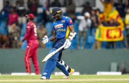 Sri Lanka's Wanindu Hasaranga celebrates after Sri Lanka won by 1 wicket during the first one day international (ODI) cricket match between Sri Lanka and West Indies at the Sinhalese Sports Club (SSC) International Cricket Stadium in Colombo on February 22, 2020. PHOTO: ISHARA S. KODIKARA / AFP