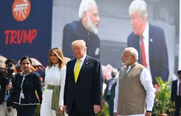 India's Prime Minister Narendra Modi (R) greets US President Donald Trump (C) and First Lady Melania Trump (2L) upon their arrival at Sardar Vallabhbhai Patel International Airport in Ahmedabad on February 24, 2020. (Photo by Mandel NGAN / AFP)