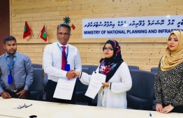 A photograph taken at the ceremony held to sign the contract for a coastal protection project in Foddhoo, Noonu Atoll. PHOTO: MTCC