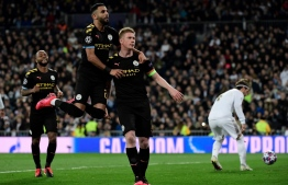 Manchester City's Belgian midfielder Kevin De Bruyne (R) celebrates his goal with teammates during the UEFA Champions League round of 16 first-leg football match between Real Madrid CF and Manchester City at the Santiago Bernabeu stadium in Madrid on February 26, 2020. (Photo by JAVIER SORIANO / AFP)