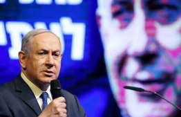 Israeli Prime Minister Benjamin Netanyahu addresses Likud party supporters during an electoral rally in the central Israeli city of Ramat Gan, on February 29, 2020. - Next week's election is expected to be another close race between Netanyahu's right-wing Likud party and the centrist Blue and White party, with the left set to perform poorly once again. (Photo by JACK GUEZ / AFP)