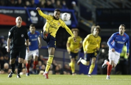 Arsenal's English midfielder Joe Willock controls the ball during the English FA Cup fifth round football match between Portsmouth and Arsenal at Fratton Park stadium in Portsmouth, southern England, on March 2, 2020. (Photo by Adrian DENNIS / AFP) / RESTRICTED TO EDITORIAL USE. No use with unauthorized audio, video, data, fixture lists, club/league logos or 'live' services. Online in-match use limited to 120 images. An additional 40 images may be used in extra time. No video emulation. Social media in-match use limited to 120 images. An additional 40 images may be used in extra time. No use in betting publications, games or single club/league/player publications. /