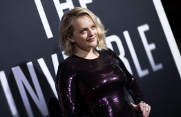 """US actress Elisabeth Moss arrives for """"The Invisible Man"""" premiere at the TCL Chinese theatre in Hollywood on February 24, 2020. (Photo by VALERIE MACON / AFP)"""