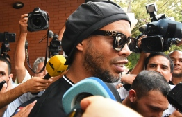 Former Brazilian football star Ronaldinho and his brother have been detained in Paraguay after allegedly using fake passports to enter the South American country, authorities said Wednesday. PHOTO: AFP