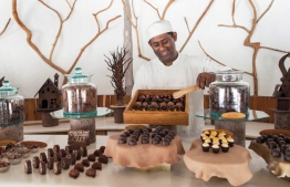 A host showcases homemade chocolate at Soneva Fushi's popular chocolate room. PHOTO/SONEVA
