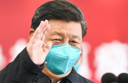 "China on Saturday reported zero new coronavirus infections for the first time since it started reporting data in January, a day after Communist Party leaders celebrated ""major achievements"" in the virus fight. PHOTO: AFP"
