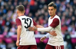 Bayern Munich's Brazilian midfielder Philippe Coutinho (R) reacts with Bayern Munich's German midfielder Joshua Kimmich during the German first division Bundesliga football match FC Bayern Munich v FC Augsburg in Munich, southern Germany on March 8, 2020. (Photo by Christof STACHE / AFP) / DFL REGULATIONS PROHIBIT ANY USE OF PHOTOGRAPHS AS IMAGE SEQUENCES AND/OR QUASI-VIDEO
