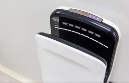 Hand dryer installed in a public restroom. IMAGE: STOCK PHOTOS