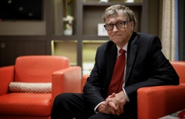 (FILES) In this file photo US Microsoft founder, Co-Chairman of the Bill & Melinda Gates Foundation, Bill Gates, poses for a picture on October 9, 2019, in Lyon, central eastern France, during the funding conference of Global Fund to Fight AIDS, Tuberculosis and Malaria. (Photo by JEFF PACHOUD / AFP)