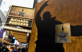 Signage at Hamilton An American Musical on Broadway on March 12, 2020 in New York City. - New York Governor Andrew Cuomo on March 12, 2020 banned public gatherings of more than 500 people, including shows in Manhattan's iconic Broadway theater district. Only schools, hospitals, nursing homes and mass transit facitilities are excepted from the rule -- which goes into effect for Broadway at 5:00 pm March 12, 2020, and 24 hours later everywhere else, Cuomo told journalists. (Photo by Angela Weiss / AFP)