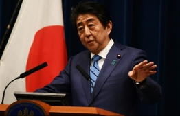 Japanese Prime Minister Shinzo Abe on Saturday said the Olympic Games would proceed as planned. PHOTO: AFPc