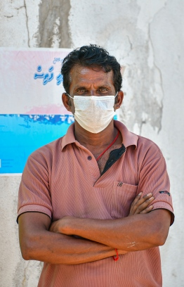 Malé, March 19, 2020: A man wearing a face mask poses for a picture. Residents in Malé city reacts to the COVID-19 outbreak by wearing the face mask. PHOTO: AHMED AWSHAN
