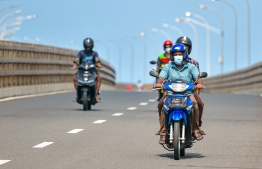 Malé, March 19, 2020: Many in Malé city are seen wearing face masks on their motorcycles on Sinamale Bridge, as a precautionary measure against COVID-19. PHOTO: AHMED AWSHAN/MIHAARU