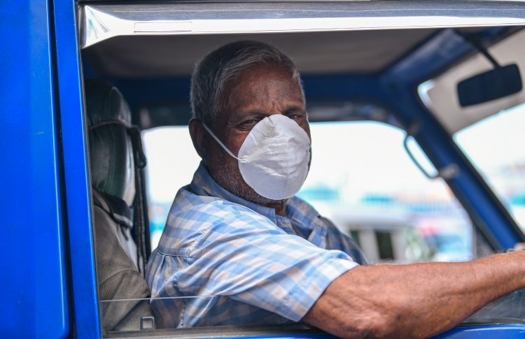 Local fontline workers continue to work, clad in protective gear, throughout the health crisis. PHOTO: MIHAARU