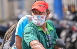 Malé, March 19, 2020: A man pictured at the local market wearing a face mask. President Solih on Wednesday waived import duties on face masks and hand sanitizers over COVID-19 outbreak. PHOTO: AHMED AWSHAN ILYAS/MIHAARU