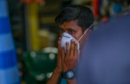 Malé, March 19, 2020: A shopkeeper pictured at the local market wearing a face mask as a preventive measure against the COVID-19. PHOTO: AHMED AWSHAN ILYAS/MIHAARU