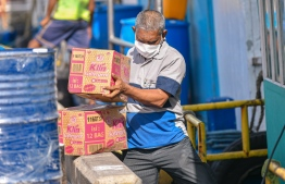 Malé, March 19, 2020: A man pictured wearing a mask he unloads boxes at the local market. Many residents in Malé city are wearing face masks as a preventive measure against the COVID-19. PHOTO: AHMED AWSHAN ILYAS / MIHAARU