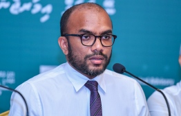 Minister of Finance Ibrahim Ameer speaking at the nation-wide broadcasted press conference. PHOTO: MIHAARU