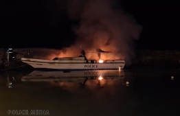 Maldives Police Service (MPS) speedboat '34' docked at jetty in Gan in Laamu atoll caught fire on Sunday morning. MPS, suspecting arson, has launched an investigation into the matter. PHOTO: POLICE MEDIA