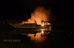 The police speedboat set on fire while docked at the harbour of Gan, Laamu Atoll on March 22. PHOTO: POLICE