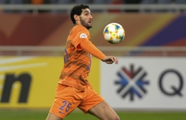 (FILES) In this file photo taken on April 9, 2019, Shandong Luneng's Marouane Fellaini controls the ball during the AFC Champions League group stage football match between China's Shandong Luneng and Malaysia's Johor Darul Ta'zim in Jinan in China's eastern Shandong province. - Fellaini has tested positive for the coronavirus, his club Shandong Luneng said on March 22, 2020, the former Manchester United player becoming the first known case in the Chinese Super League (CSL). PHOTO: STR / AFP