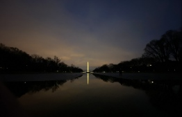 The Washington monument is seen in the early evening hours as tourists and Washingtonians have deserted the Mall in Washington, DC. on March 23, 2020. PHOTO: ERIC BARADAT / AFP