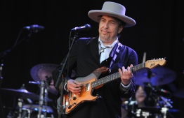 (FILES) In this file photo taken on July 22, 2012, Bob Dylan performs during the 21st edition of the Vieilles Charrues music festival in Carhaix-Plouguer, western France. - Dylan surprised fans overnight into March 27, 2020, by releasing his first original music in eight years, a 17-minute ballad about the assassination of John F. Kennedy. (Photo by Fred TANNEAU / AFP)