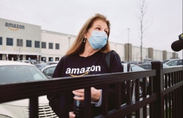NEW YORK, NEW YORK - MARCH 30: Amazon employees hold a protest and walkout over conditions at the company's Staten Island distribution facility on March 30, 2020 in New York City. Workers at the facility, which has had numerous employees test positive for the coronavirus, want to call attention to what they say is a lack of protections for employees who continue to come to work amid the coronavirus outbreak.  PHOTO: AFP
