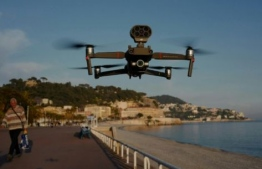 """""""A message from a drone catches your attention and avoids police having to meet the person face to face,"""" notes Stephane Morelli, co-founder of Azur Drones. PHOTO: AFP"""
