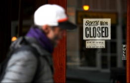A pedestrian walks by a closed sign on the door of a restaurant on March 17, 2020 in San Francisco, California. Due to the coronavirus pandemic, several Americans are struggling to keep up with rent and bills. PHOTO: GETTY IMAGES