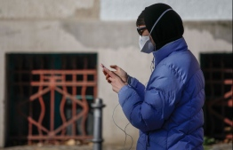 In Germany, a proposed smartphone app will track and record people's interactions via Bluetooth for two weeks, without using geolocation tracking and with a promise that data will be securely protected. PHOTO: AFP