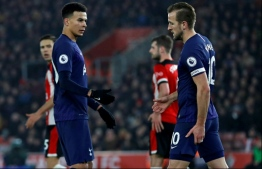 Premier League stars like Tottenham Hotspur's English midfielder Dele Alli and Harry Kane are increasingly in the spotlight to take a cut in their huge wages as others suffer in the coronavirus pandemic PHOTO: AFP